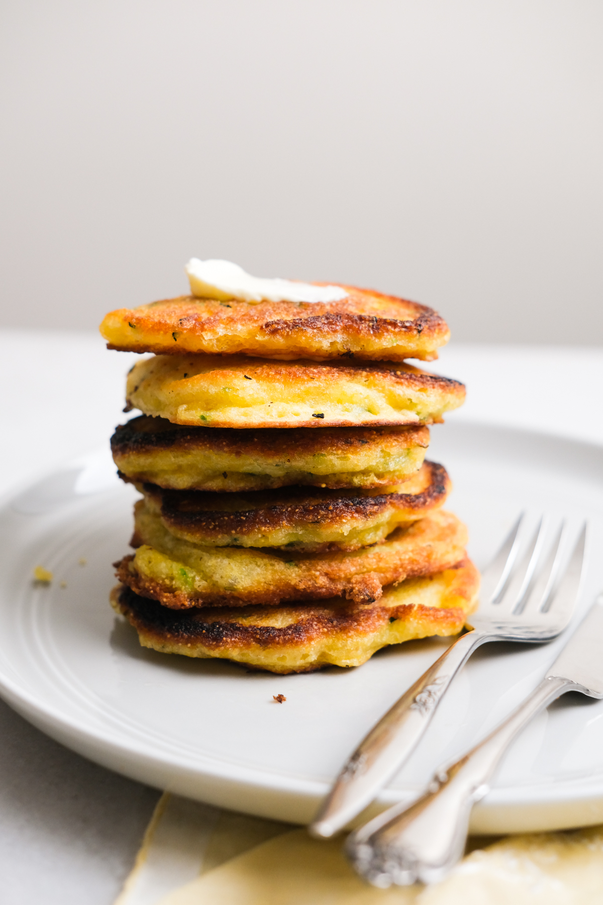 zucchini fritters stacked up on a plate