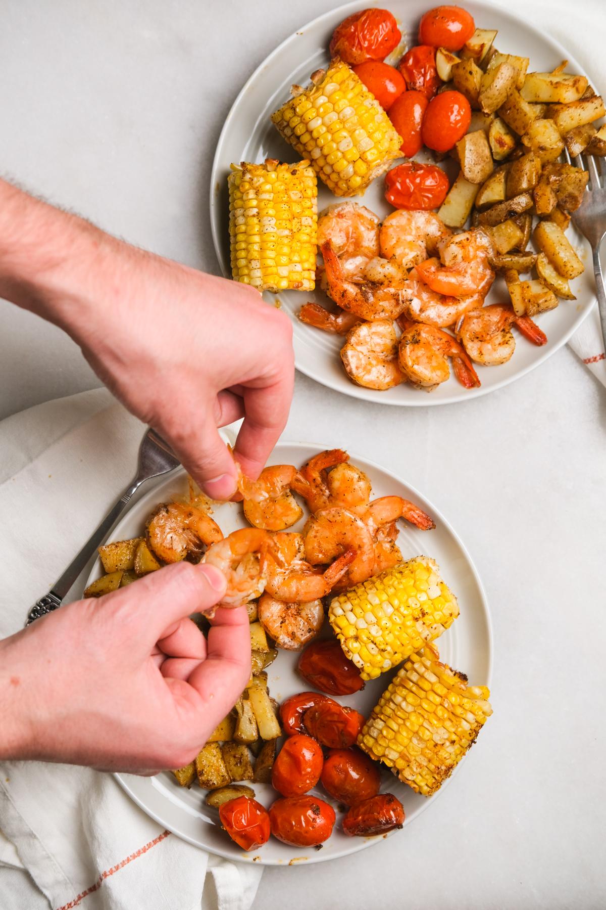 peeling a shrimp for cajun dinner