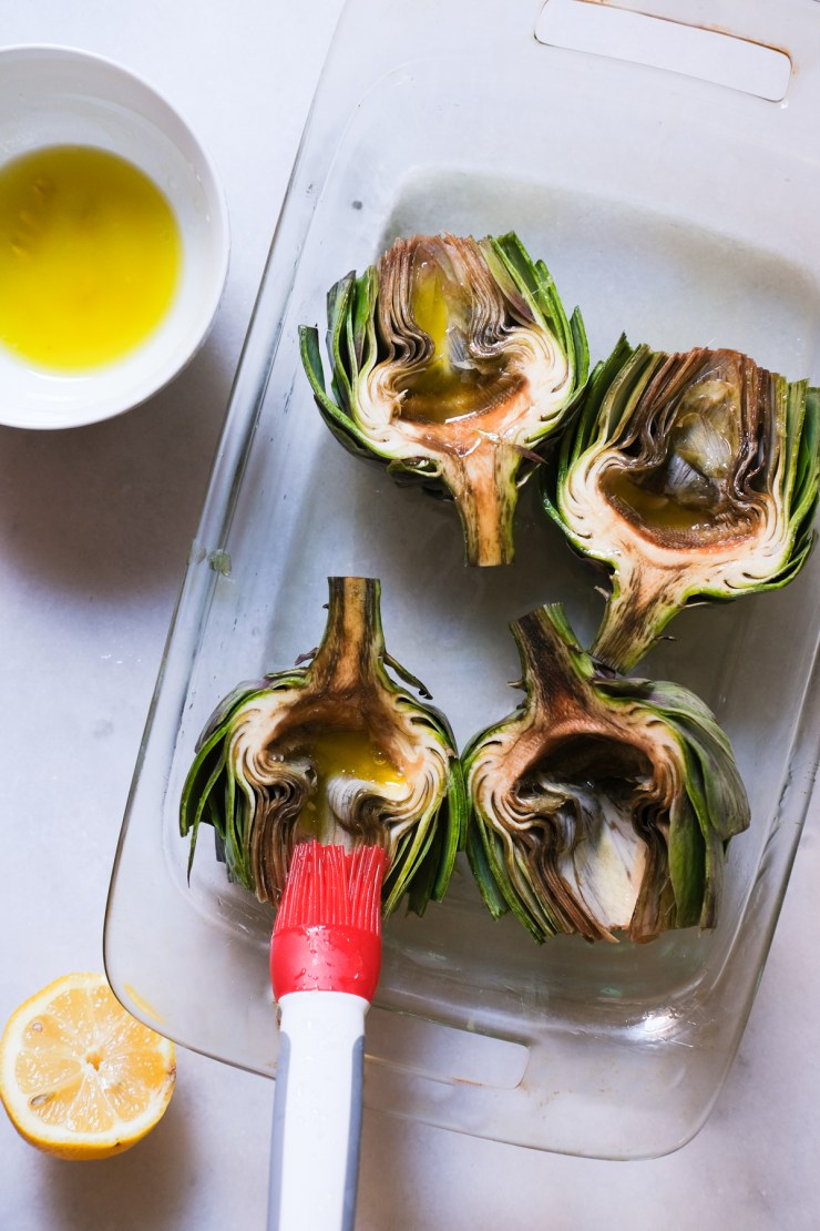 brushing artichokes with lemon and water