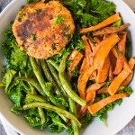 salmon patties on a lemon kale salad