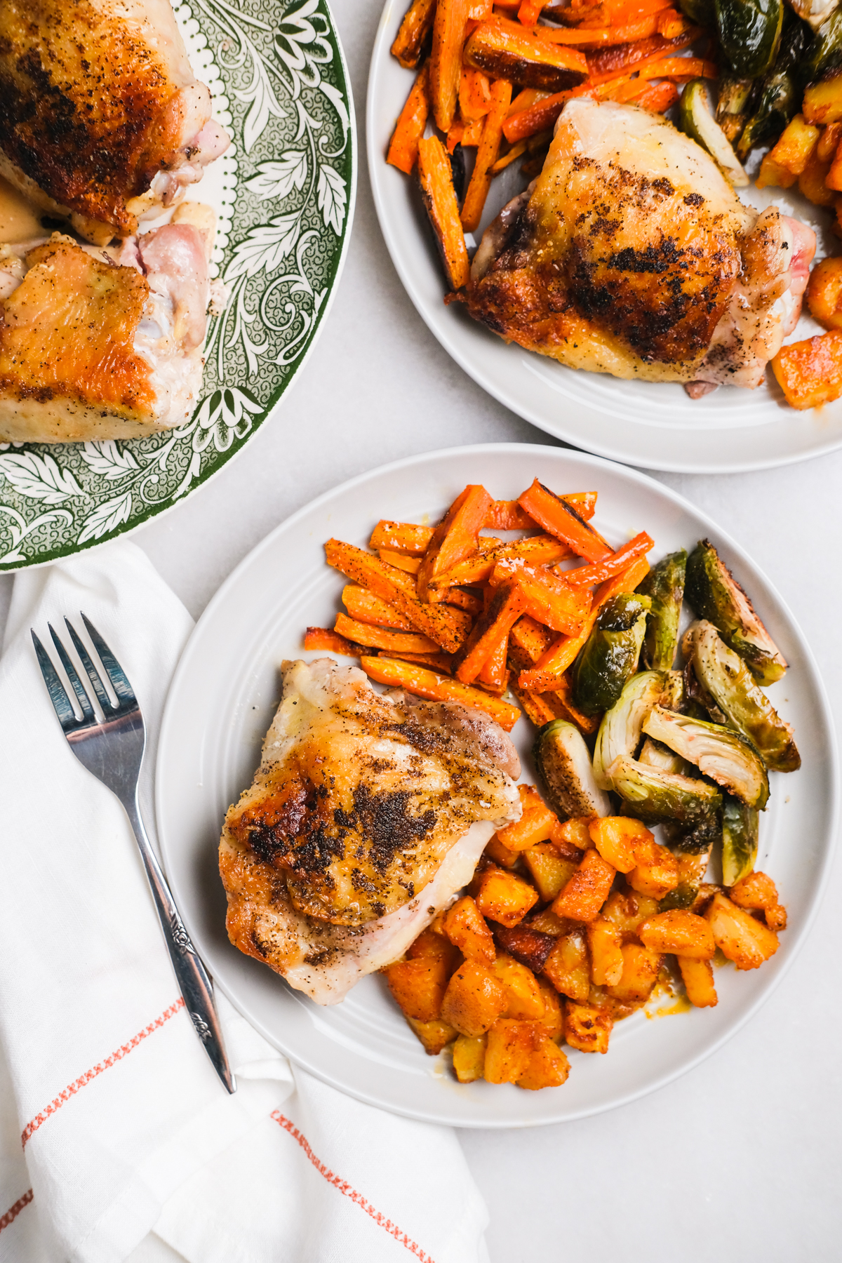 chicken thigh dinner with roasted vegetables and potatoes