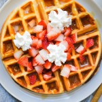 protein waffle with strawberries and whipped cream