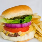 classic cheeseburger with chips on a plate