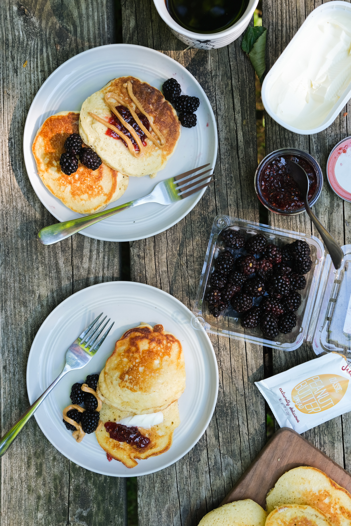 pancakes with alternative toppings on a picnic table