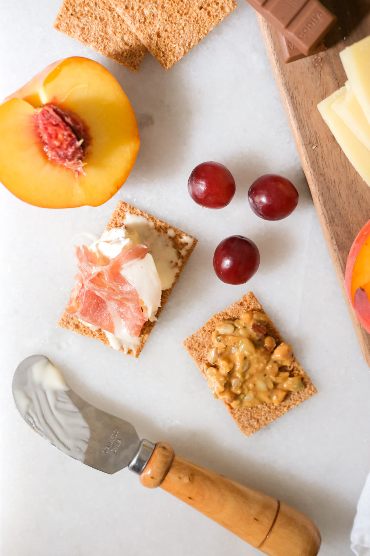crispbread with cheese and nuts and meat with fruit