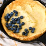 buttermilk dutch baby in a skillet with berries
