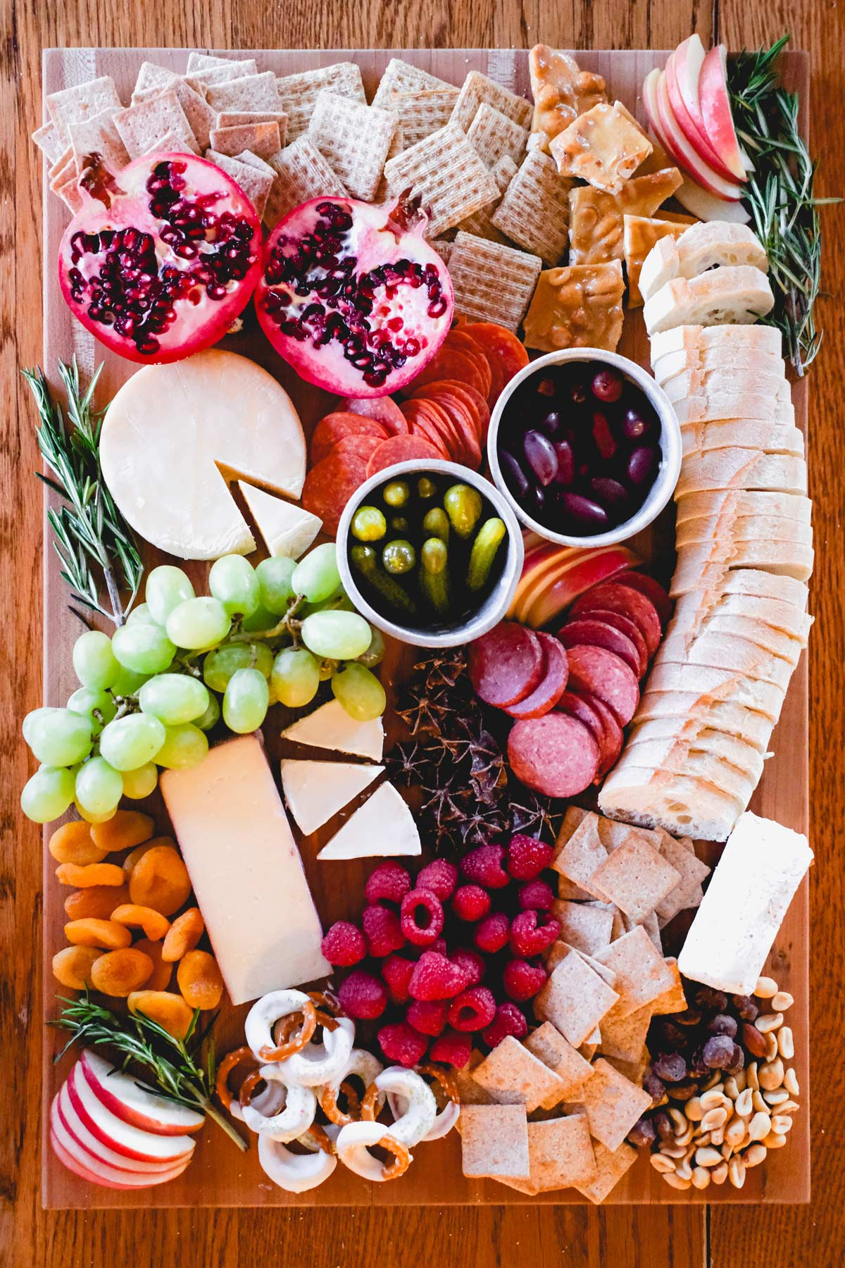 holiday charcuterie board with cheese meat fruit and chocolate