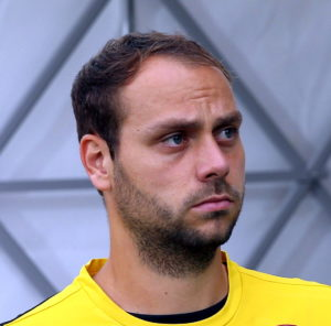 Portraitfoto Rico Benatelli, Spieler vom FC St. Pauli (damals noch im gelb-schwarzen Trikot von Dynamo Dresden).