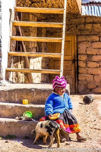 Girl with Piglet, Andes, Peru