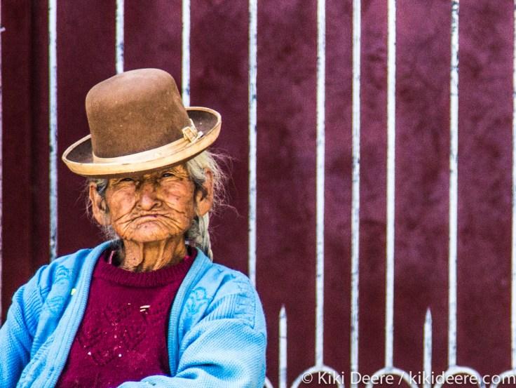 Woman Sitting on Church Steps, Puno, Peru