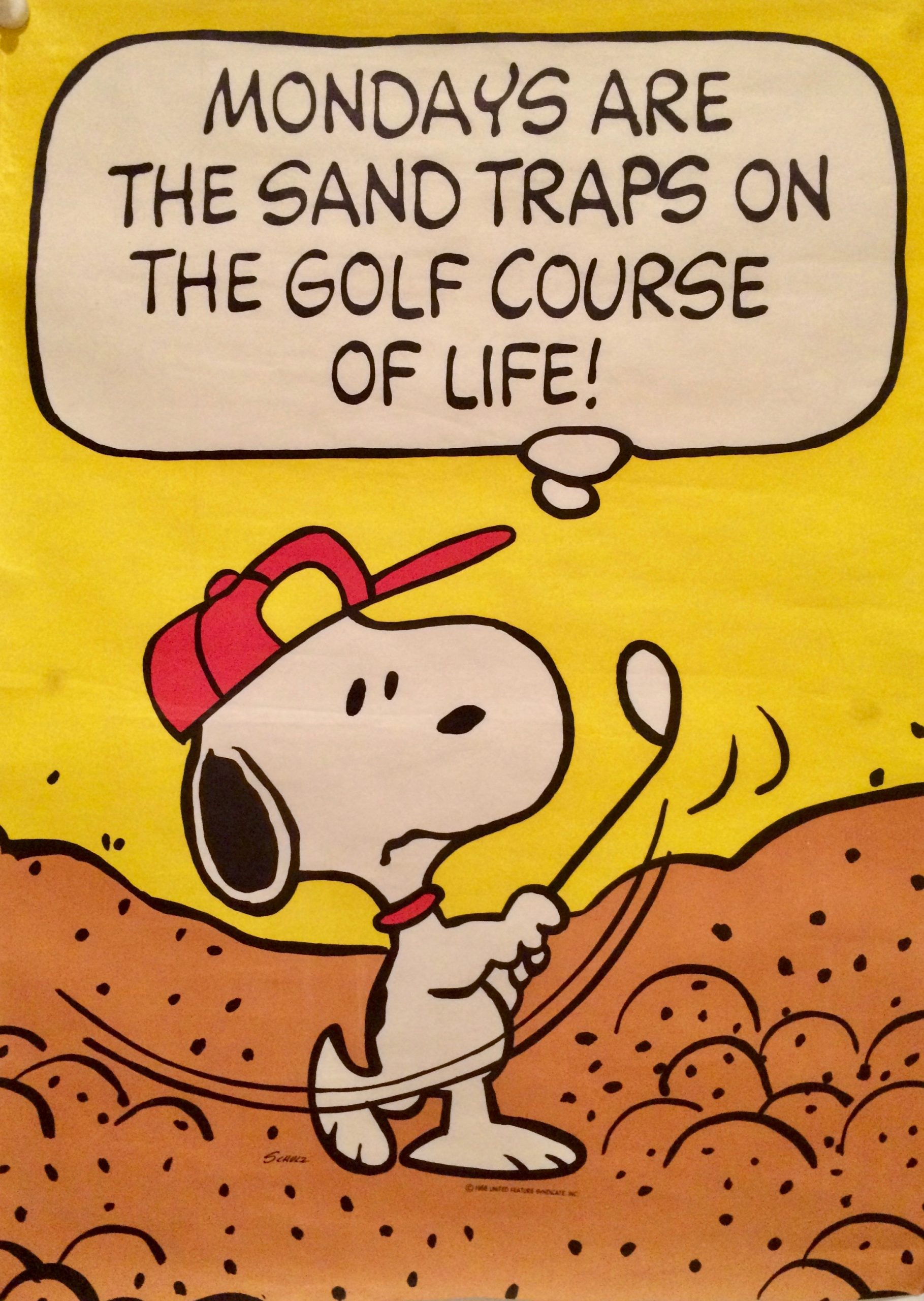 Snoopy paying golf, in a bunker