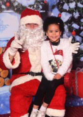 Aisha Clifford with Santa
