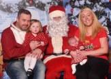 Children Jade and Margaret with parents James Quilligan and Amanda Buckley and Santa