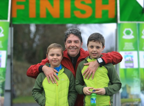 Davide Mosca greeted by his sons, Marco and Luca, after competing in the 10K