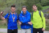 Event organiser Piaras Kelly (centre) congratulating Eanna Kavanagh (right) and Conor O'Riordan, who participated in The Killarney Ultimate High Peaks Challenge