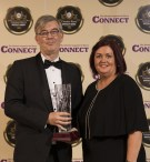 Patrick O'Donoghue receives the Lifetime Achievement Award from Margaret Kissane, Connect Kerry