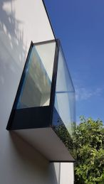 A projecting glass window in Hawley Mews