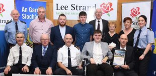 When Ian O'Connell received his Garda Youth Achievement Award last year, his best buddy, Michael (back centre) was there to celebrate with him. Also included are Supt Flor Murphy, Gerry Dwyer, Chief Supt Tom Myers and Donal Pierce, Sgt Dermot O'Connell, Ian's dad Michael O'Connell, John Doona, Seán Coffey, Ian'smum Nora O'Connell, Freda Doona and Garda Diane Collins