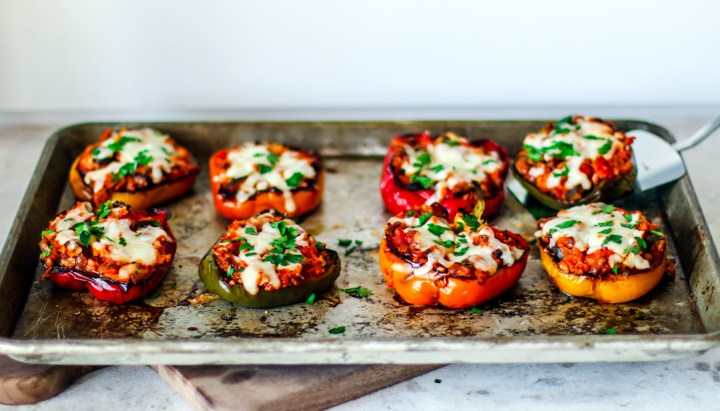 Cooked stuffed peppers on a baking sheet.