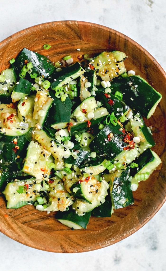 Close up of Sichuan Smashed Cucumbers with hot chili oil in a bowl.