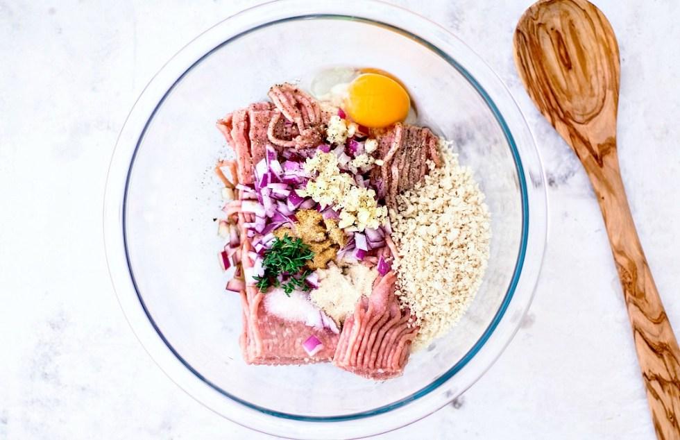 Raw turkey meatball ingredients in a bowl.