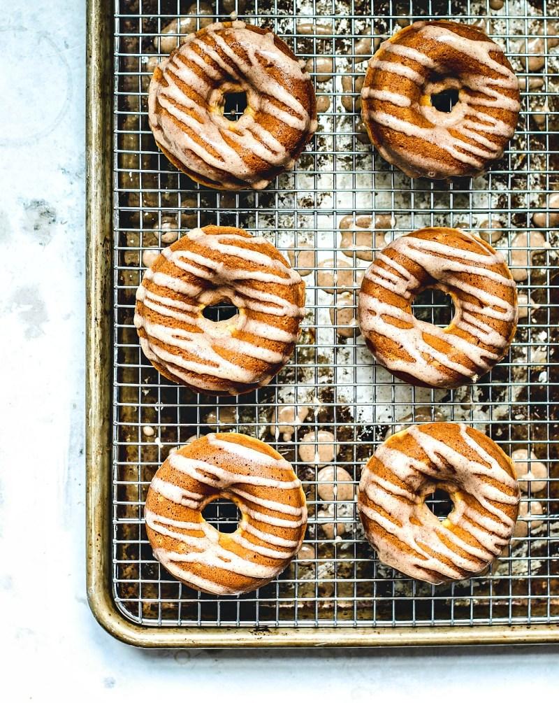 Eggnog donuts on a cooling rack.