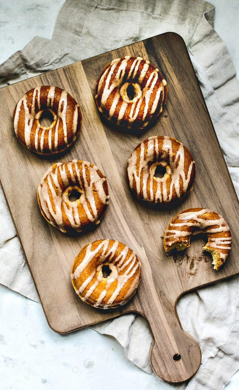 Eggnog donuts drizzled with glaze.
