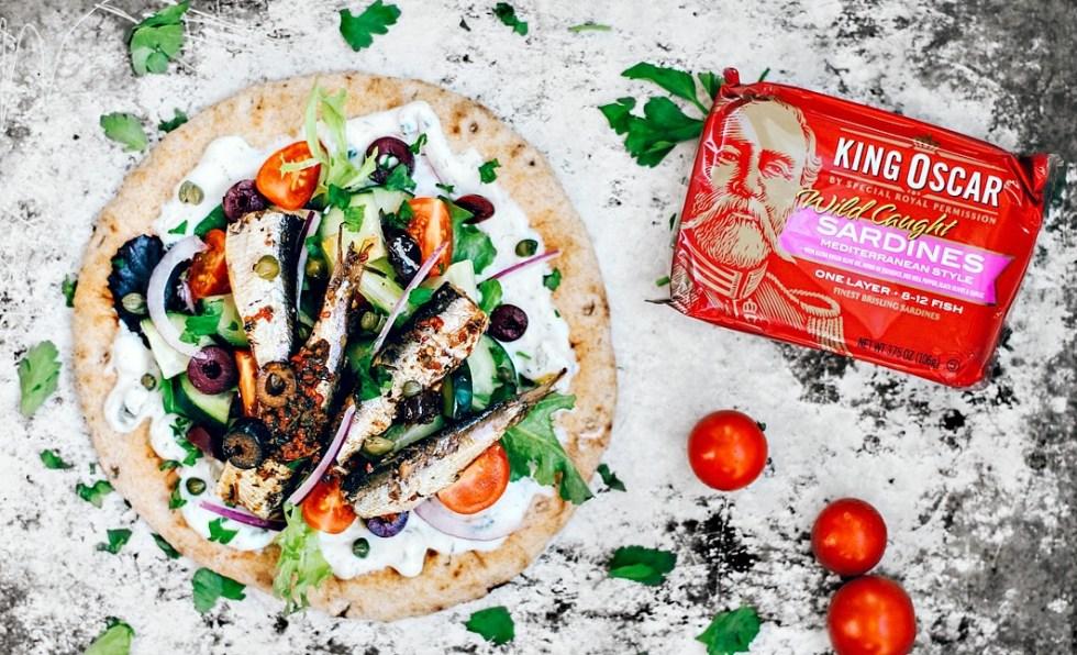 Pita topped with tzatziki, fresh veggies, and Mediterranean sardines.