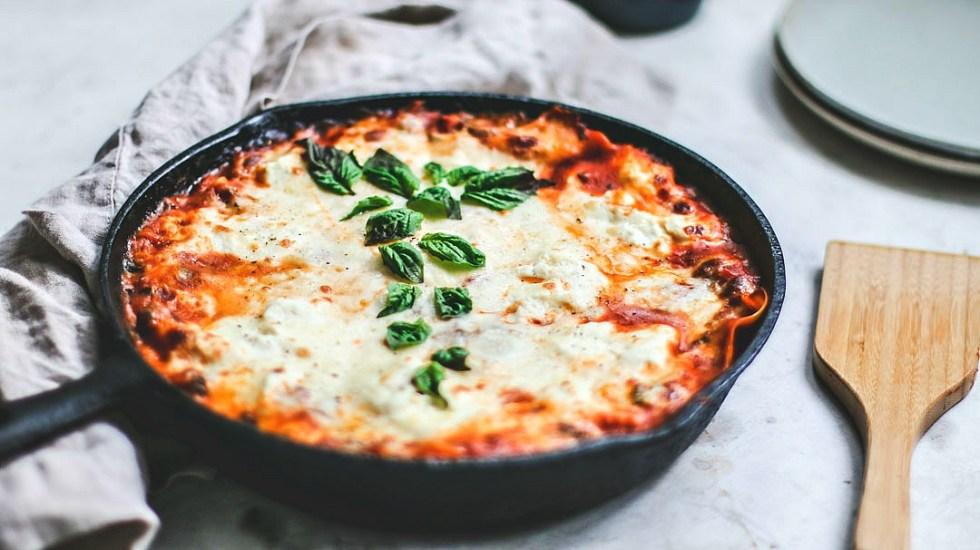 Close up of skillet of lasagna.