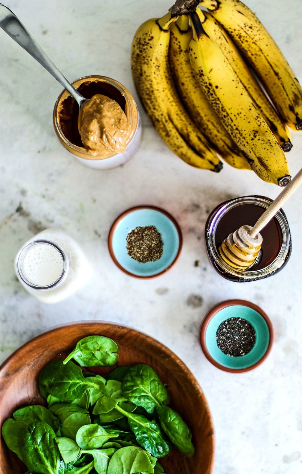 Peanut Butter Banana Spinach Smoothie ingredients on table.