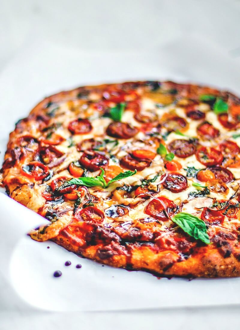 Bruschetta Pizza drizzled with balsamic vinegar.