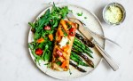 Plate of Grilled Mahi Mahi with bright salad and veggies.