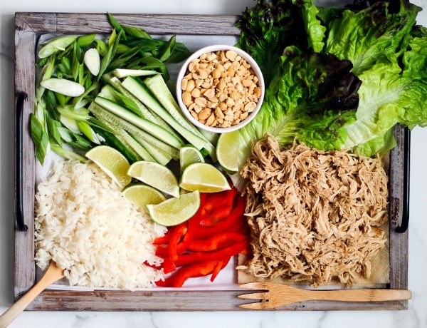 Lettuce wrap ingredients sprawled over platter.