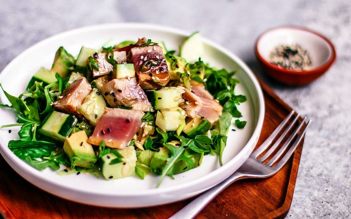 Close up of plate of grilled tuna steak salad.