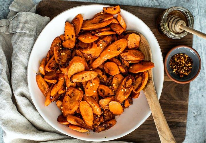 Bowl of hot honey roasted carrots.