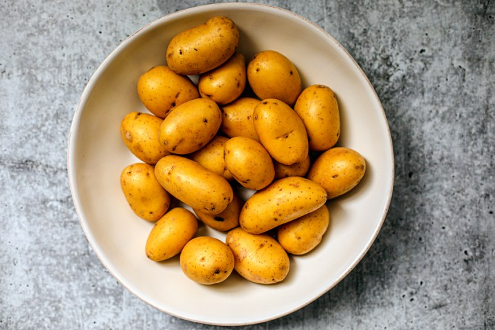 Small potatoes in a large white bowl.
