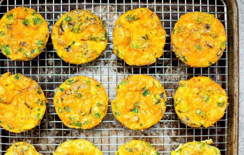 Egg muffins lined up on a cooling rack.