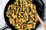 Skillet full of prepared rigatoni pasta.
