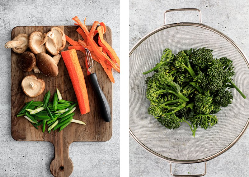 Vegetables, cut and washed, on cutting board and in strainer.