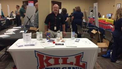 Photo of Athan Representing KTC at Company Health Expo