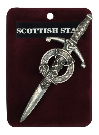 A sword shaped kilt pin with a stag head by the hilt.