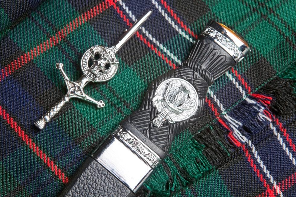 Tartan kilt pin and scottish knife on a kilt