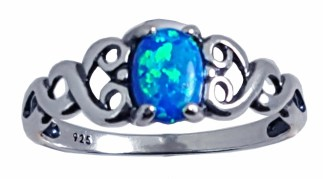 "This is a beautiful ring with lab created blue opal that sparkles. The hearts on the side are the perfect way to say ""I love you"" or to remind you to love yourself. Made in the U.S.A. Lab created blue opal, Each stone is unique. Metal: Sterling silver"