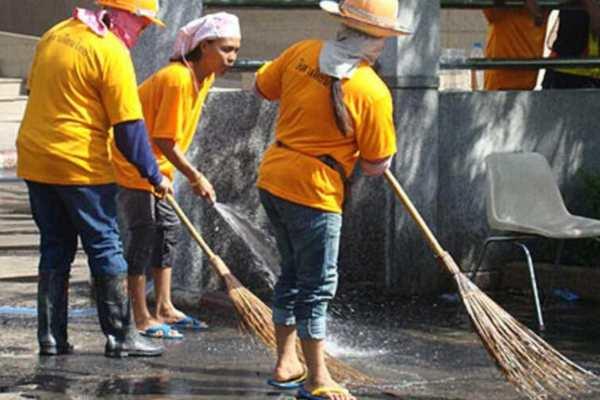 Thai street cleaners.