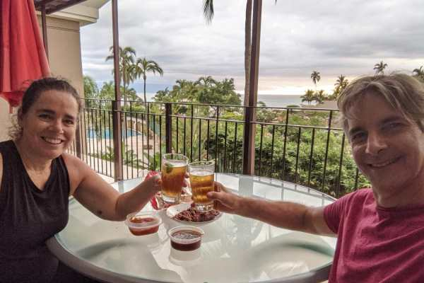 Kim and Way with drinks and chips and salsa in Puerto Vallarta, Mexico
