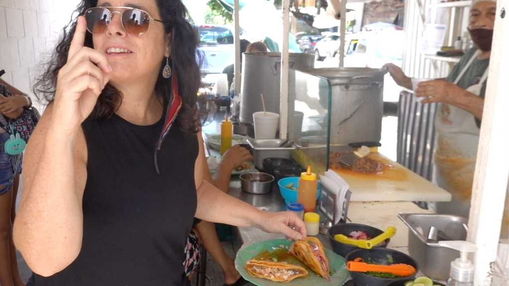 Kim eating the number one taco in the world. Birria tacos in Puerto Vallarta, Mexico