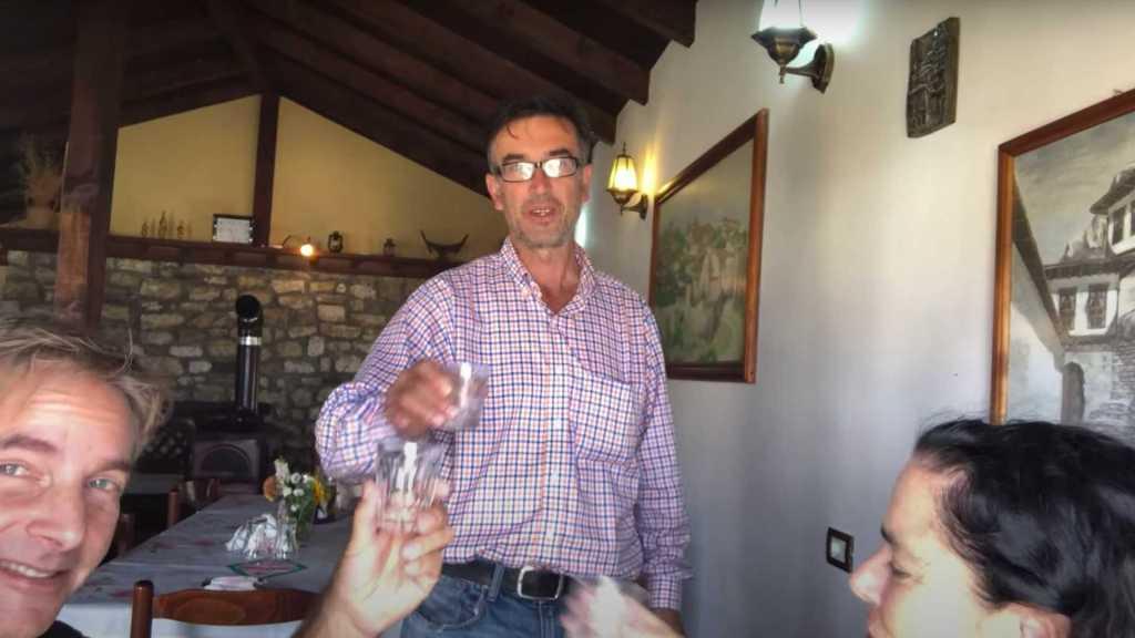 Friendly owner of Antipatrea in Berat, Albania treating us to raki
