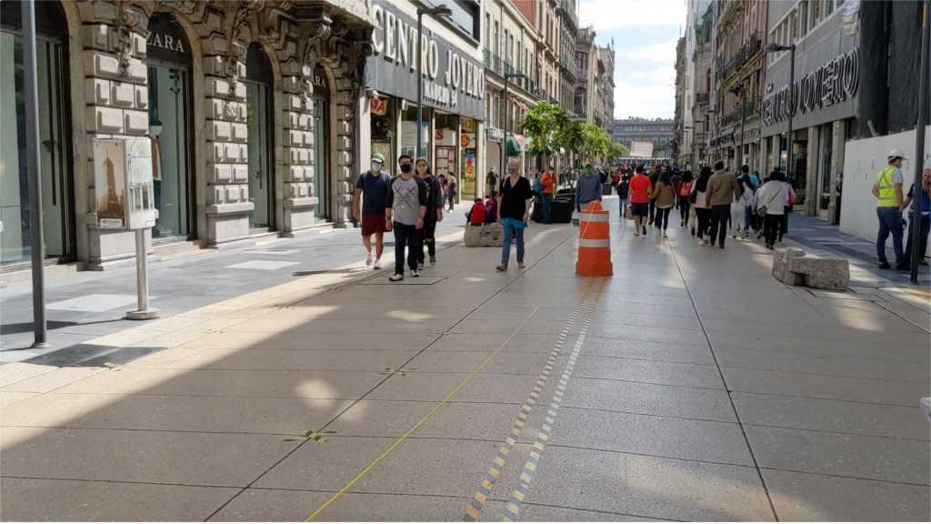Walking street in Mexico City, Mexico with barriers for one-way traffic flow