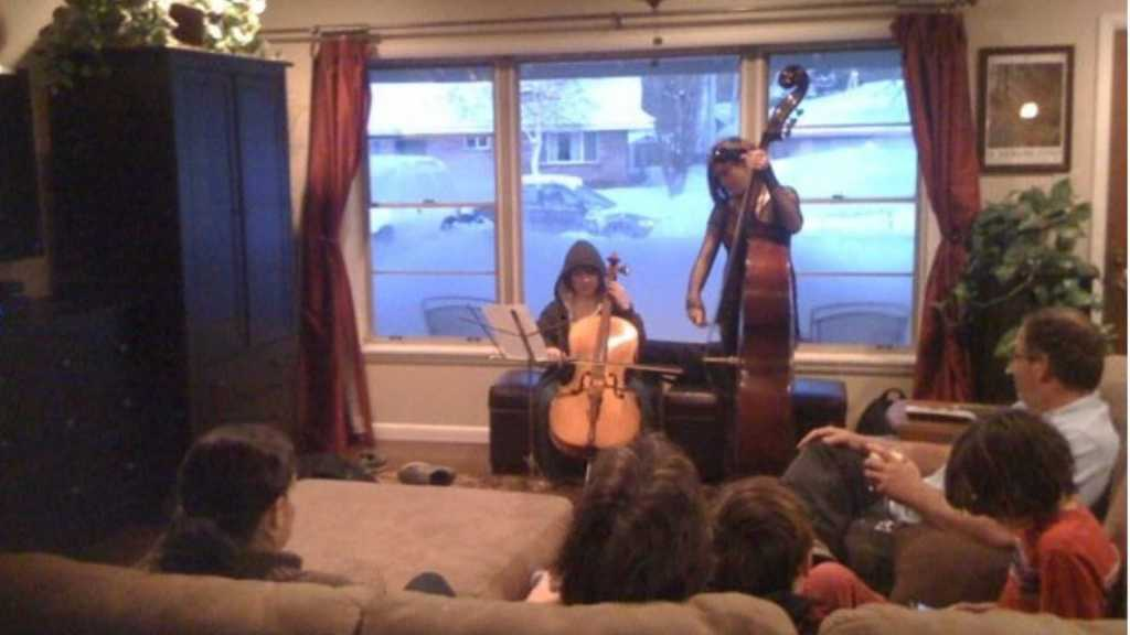 Our last owned home before living in Airbnbs. B and C playing cello and bass