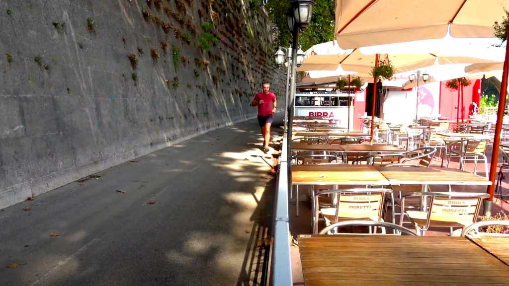 Way running past a cafè along the Tiber River, Rome, Italy